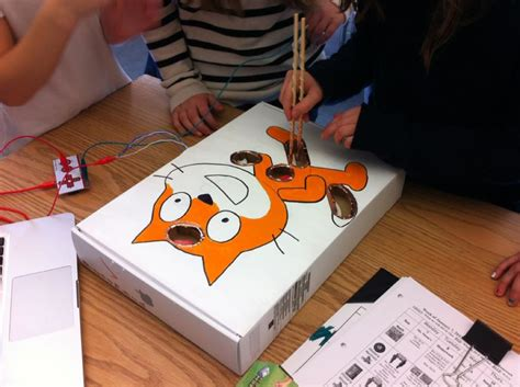 Students playing #scratch Operation with a #makeymakey #