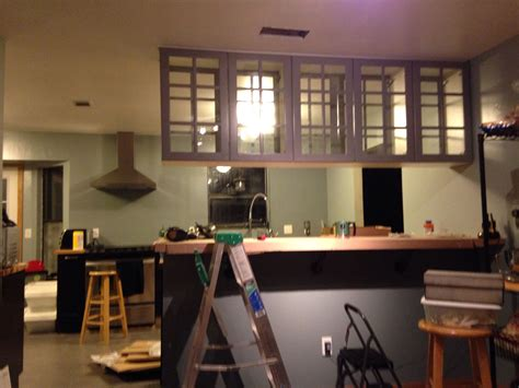 Ceiling mounted cabinets with doors on both sides